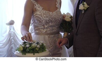 Bride and groom exchanging wedding rings at ceremony