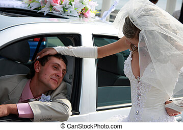 Bride and groom. Groom in the car