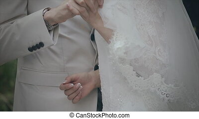 Bride and groom hands loving couple close up