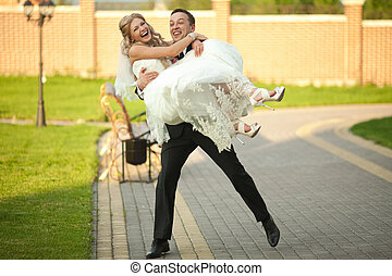 Bride and groom have fun whirling in the garden
