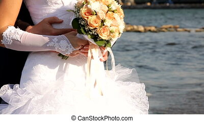 Bride and groom holding a bouquet