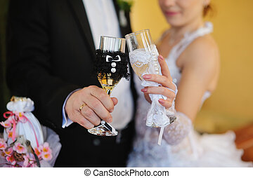bride and groom holding beautiful wedding champagne glasses