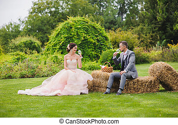 Bride and groom holding wine glasses