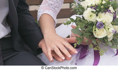 Bride and groom hugging each other hands
