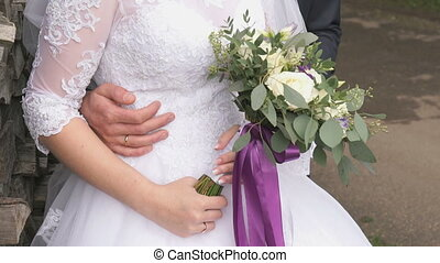Bride and groom hugging each other on wedding