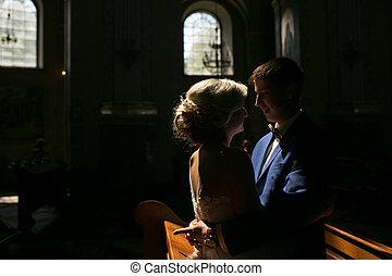 bride and groom illuminated by light