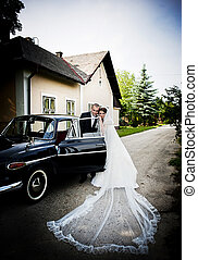 Bride and groom in car