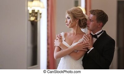 Bride and groom in palace indoors