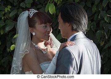 bride and groom in romantic spot under tree