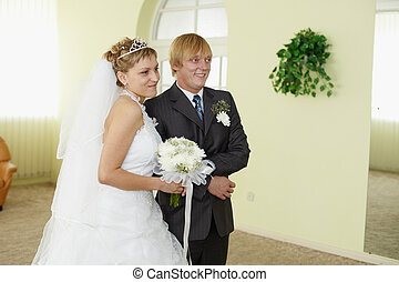 Bride and groom in solemn moment