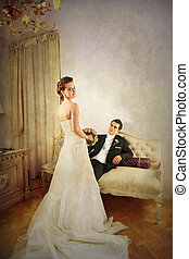 Bride and Groom in vintage interior - Full length of bride...