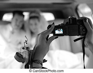 Bride and groom in wedding limo - A portrait of a bride and...