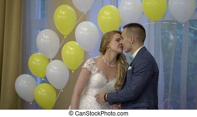 Bride and groom kissing at the wedding party