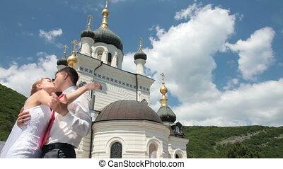 kissing near the church