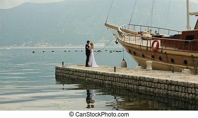 Bride and groom kissing on the berth on Montenegro, Budva -...