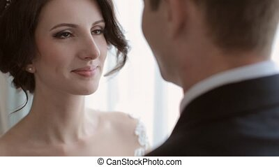 Bride and groom looking at each other with love