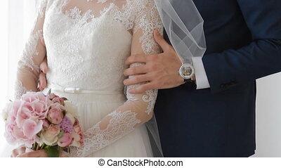 Bride and groom near the window