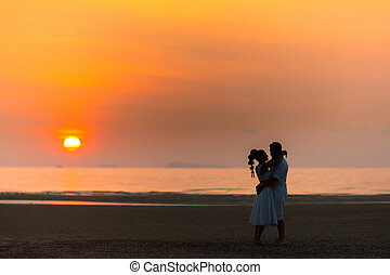 https://cdn.xxl.thumbs.canstockphoto.com/bride-and-groom-on-a-tropical-beach-with-the-sunset-in-the-background-picture_csp36025313.jpg