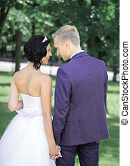 bride and groom on a walk in the Park