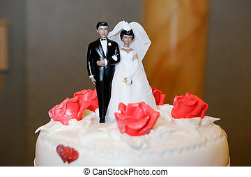 Bride and groom on cake