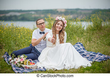 bride and groom on grass in park