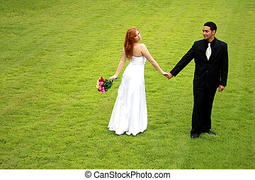 Bride and Groom on Green Lawn