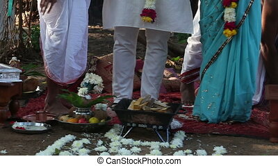 bride and groom on Indian wedding ceremony - European bride...
