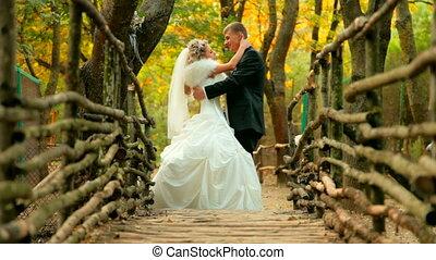 bride and groom on old bridge