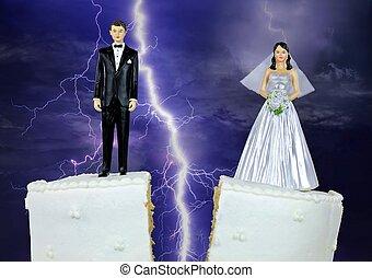 bride and groom on split wedding cake
