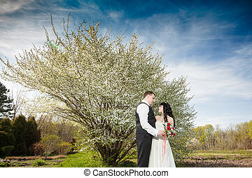 Bride and groom on the blue sky