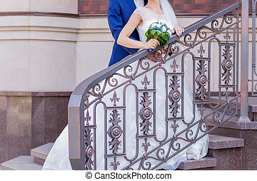 bride and groom on the veranda of the house