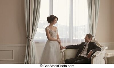 Bride and groom posing in apartments