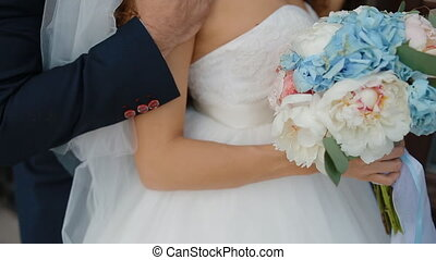 Bride and groom posing outdoors