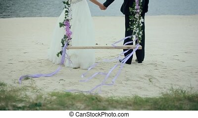 Bride and Groom Run from the Swings to Lake