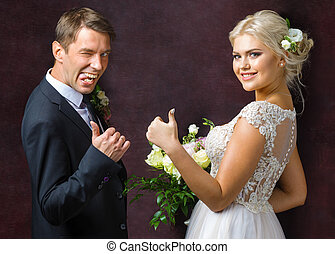 bride and groom shows a gesture of good luck