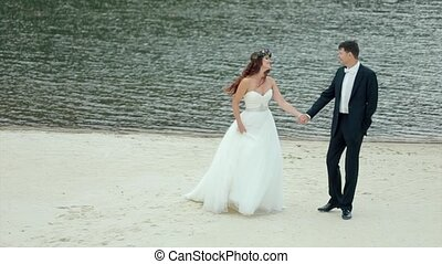 Bride and Groom Standing By the Lake. Slow Motion