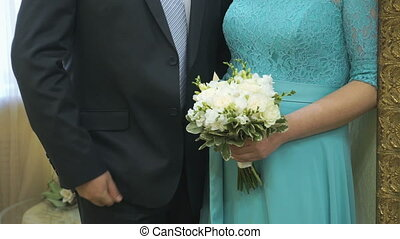 Bride and groom standing in the wedding hall - The bride and...