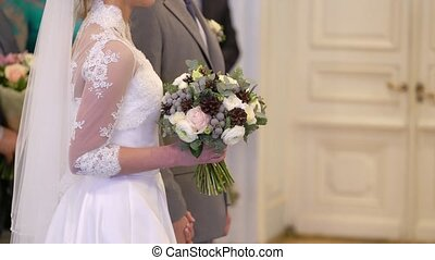 Bride and groom staying at wedding ceremony indoors