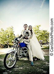 bride and groom on the motorcycle
