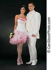 Bride and groom - Portrait of wedding couple wearing white...