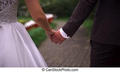 Bride and groom walking hands