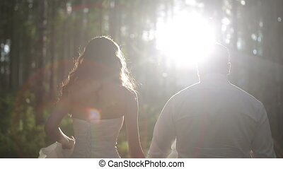 Bride and Groom walking together in forest