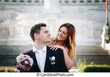 Bride and groom wedding poses in front of Altar of the Fatherland (Altare della Patria), Rome, Italy