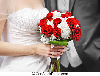 Bride and groom with bridal bouquet