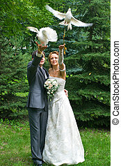 bride and groom with pigeons