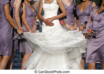 The bride and his girlfriends in identical dresses