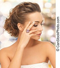 woman with purple cocktail ring