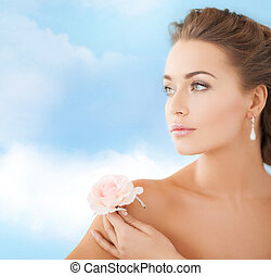 young woman with rose flower
