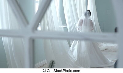 Bride at photo shooting, reflection in mirror