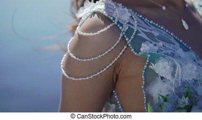 Bride at sail yacht waving ribbons